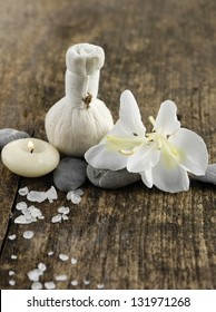 Salt and white orchid , stones ,candle on old wood background