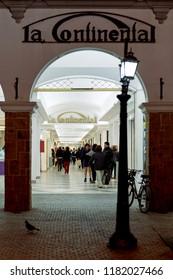 Salta, Salta, Argentina, Aug. 3, 2017: Gate of La Continental Mall Gallery Night Urbanscape w. Colonial Street Lamp of European Traditonal Buildings of Salta City Northern Argentina