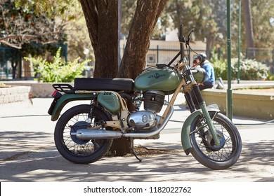 Salta, Salta, Argentina, Aug. 4, 2017: Vintage Gilera 200 Custom Rare Scooter Conserved Portrait at San Martin Mark hill San Bernard Salta Northern Argentina