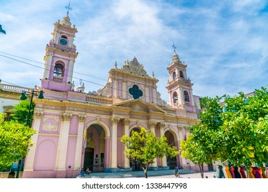 Salta, Argentina - February 3th 2019, Tourist sitting on the stairs of the Catedral Basilica de Salta at the city park 'Plaza 9 de Julio' square July the 9th