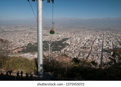 Salta, Argentina. July 8, 2010. The shadow of tourists and the touristic cable car are seen in this view of the City of Salta from Cerro San Bernardo.