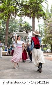 SALTA, ARGENTINA - OCTOBER 2018: Couples dancing the Tango for tourists on a square in Salta, Argentina.