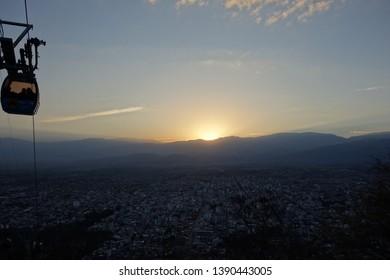 Salta/Argentina - Sep.19.18: cablecar of salta. topview at sunset
