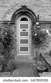 Saltaire - Victorian model village in Shipley (England) listed as UNESCO World Heritage Site. Old door. Black and white retro style.
