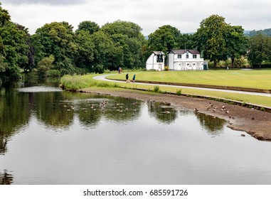 SALTAIRE, YORKSHIRE, UK - JULY 11, 2017: Unidentified people enjoy walking around the cricket club in Roberts Park.