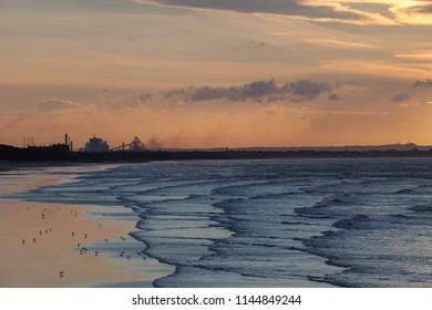 Saltburn beach and in the distance the blast furnace and industry of Redcar