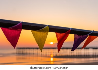 Saltburn at sunrise. Bunting attached to the pier railings. Saltburn is a small seaside town located on the north east coast of England.