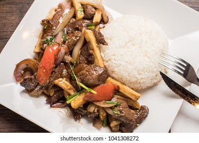 Salted beef,lomo saltado ,Peruvian gastronomy with rice on a square dish