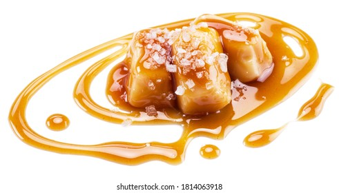 Salted caramel candies covered with melted sugar caramel isolated on white background.