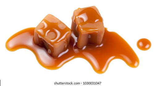 Salted caramel fudge candies  isolated on white background. Golden Butterscotch toffee sauce. Pieces of caramel candy with sea salt, macro