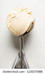Salted caramel ice creams on ice cream scoop