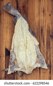 salted cod fish on wooden background