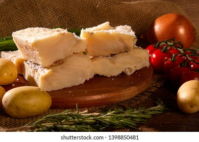 salted codfish on the wooden table with ingredients. Codfish raw.