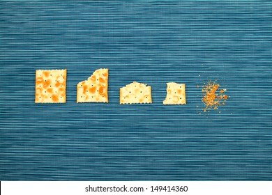 Salted crackers bitten process, background