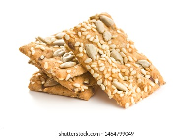 Salted crispy crackers with sesame and sunflower seeds isolated on white background.