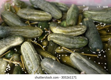 Salted cucumbers in the box at a market