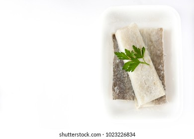 Salted dried cod isolated on white background. Top view copyspace.Typical Easter food