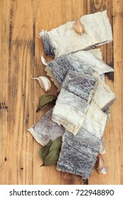 salted dry codfish on wooden background