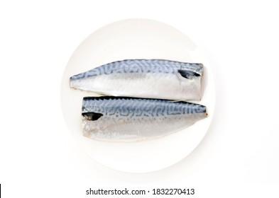Salted fish mackerel fillet on white plate