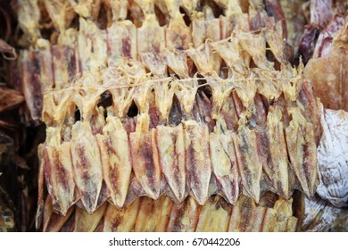 salted flat dry squid for slae at seafood market