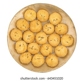 Salted Flavor Small Cumin Cookies or Biscuits Served in Plate Also Know as Nan Khatai or Jeera Cookies is a tea time Snack. Little Sweet and Little Salty isolated on White Background