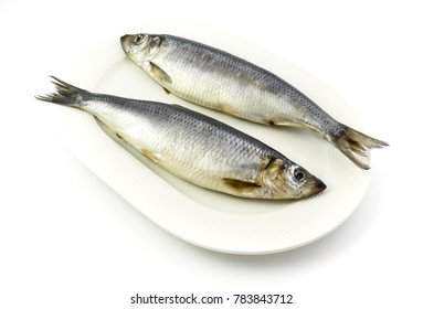 Salted herrings on the plate, isolated on white background.