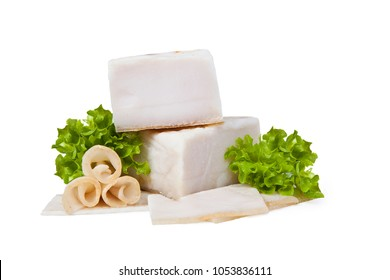 Salted lard. Whole and partially sliced. Isolated on white background. Thinly sliced slices decorated with leaf of lettuce