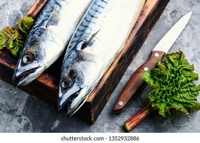 Salted mackerel on a kitchen board.Smoked mackerel