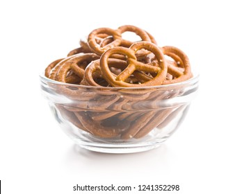 Salted mini pretzels snack in bowl isolated on white background.