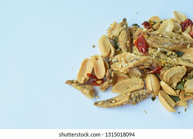 Salted peanuts mixed with crispy fish Put on a white background