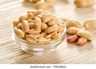 salted peanuts on wooden background