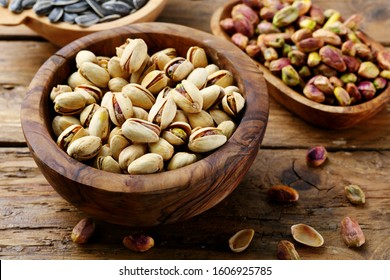 salted pistachio in wooden bowl rustic background