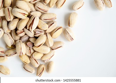 Salted pistachios on a white background