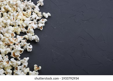 Salted popcorn on a concrete, stone background. Top view