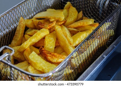 salted potato chips, freshly cooked in the fryer
