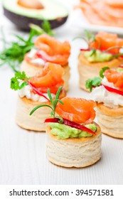salted  puff pastry stuffed with cream cheese and smoked salmon on white background