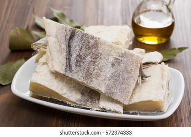 salted raw dry cod fish on dish