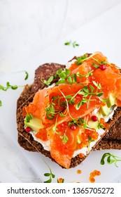 Salted salmon, red caviar, avocado and cream cheese rye crisp toast