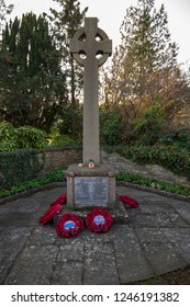Saltford, Bath UK, 25 November 2018: Saltford War Memorial, surrounded by poppy wreaths after the 100 year anniversary