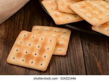 Saltine crackers on dark wooden table