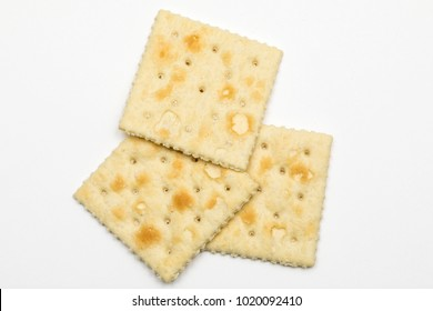 Saltine crackers shot close uo with a macro lens white background