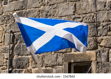 The Saltire, or Saint Andrew's Cross, the Scottish flag, fluttering in the winfd in Edinburgh