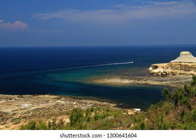 Saltpans, Qbajjar Bay west of Marsalforn, Gozo, Malta