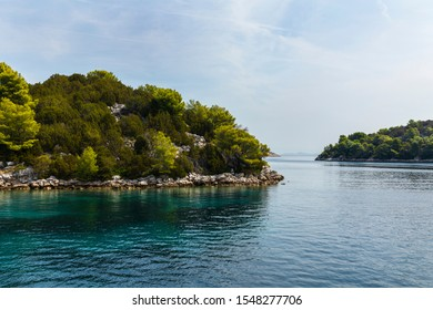 Saltwater bright colored lakes of malo and veliko jezero at the National Park on the island Mljet, Croatia. Mediterranean adriatic coast with greenery creating a serene calm scene, UNESCO protected