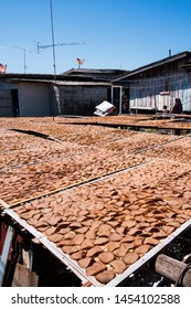 Saltwater fish cracker lay on bamboo racks for natural drying at fisherman village yard in Narathiwat, Southern Thailand. Focus on saltwater fish cracker.
