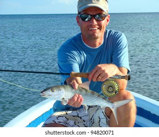 Saltwater Fly Fisherman with the elusive bonefish, fly rod and reel