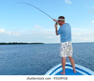 Saltwater fly fishing for bonefish - Fighting a big fish in the ocean off the front of a boat