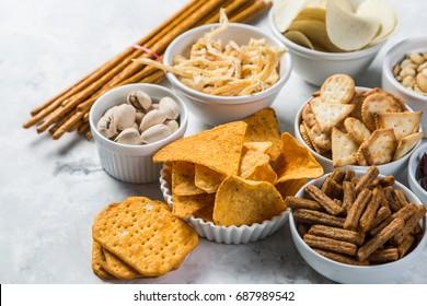 Salty beer snacks in whit bowls