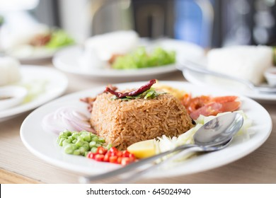 Salty brown fried Thai fried rice with assorted sweet pork and vegetable