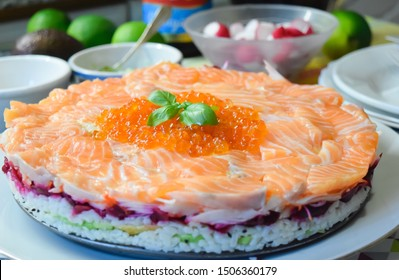 Salty cake, homemade for my son birthday. With fresh salmon, salmon fish eggs, Japanese rice, and different ingredients of the simple menu « Sushi « .